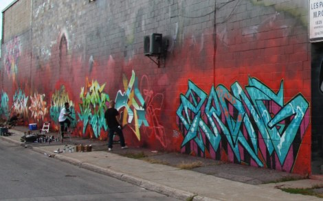 artists at work on Cabot graffiti wall